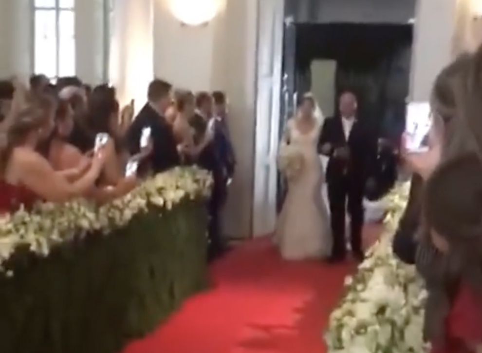 Wedding Guest falls into the aisle while filming on her Phone